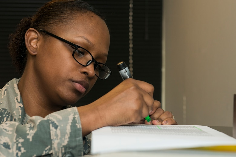 U.S. Air Force Staff Sgt. Jasmine Turner, 20th Force Support Squadron career development supervisor, highlights information while going through folders at Shaw Air Force Base, South Carolina, Nov. 13, 2017.