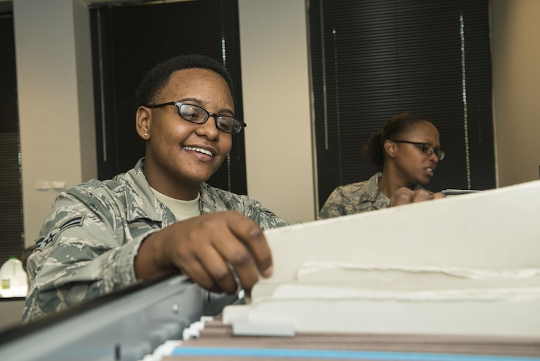 U.S. Air Force Airman 1st Class Lakeia Garner, 20th Force Support Squadron (FSS) outbound assignments personnel specialist, reviews folders while Staff Sgt. Jasmine Turner, 20th FSS career development supervisor, marks off names at Shaw Air Force Base, South Carolina, Nov. 13, 2017.