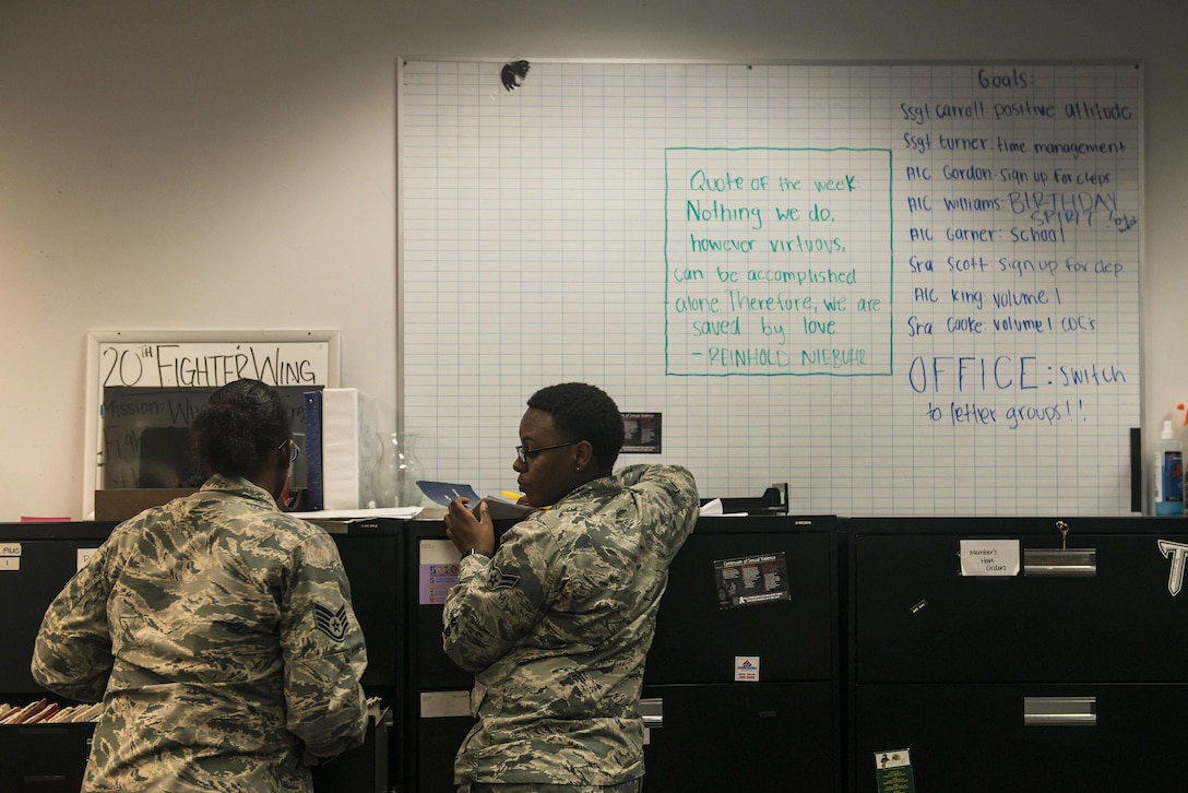 U.S. Air Force Staff Sgt. Jasmine Turner, 20th Force Support Squadron (FSS) career development supervisor, left, and Airman 1st Class Lakeia Garner, 20th FSS outbound assignments personnel specialist, work on the office goal to transition to letter groups at Shaw Air Force Base, South Carolina, Nov. 13, 2017.
