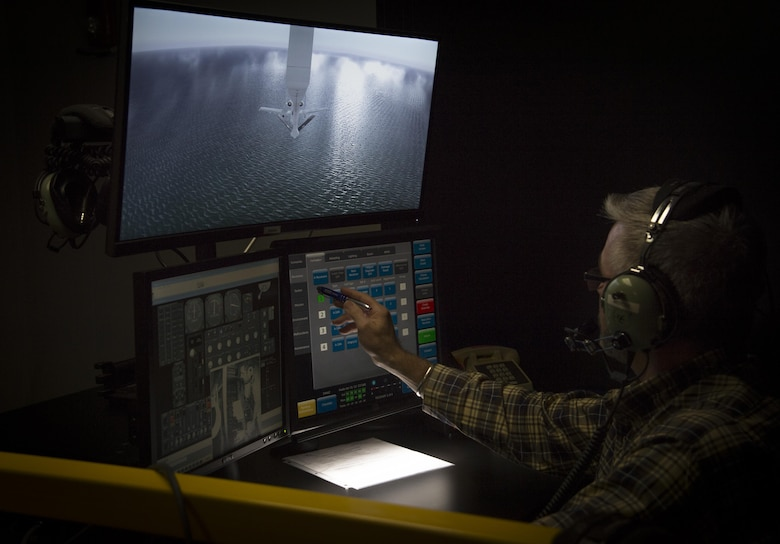 John Mercer, a Boom Operator Weapon System Trainer (BOWST) Instructor assigned to the 6th Operations Support Squadron, operates the instructor portion of the BOWST, Nov. 8, 2017, at MacDill Air Force Base, Fla. The simulator educates Airmen at all levels to be better equipped to deal with unusual circumstances during aerial refueling. (U.S. Air Force photo by Senior Airman Mariette Adams)