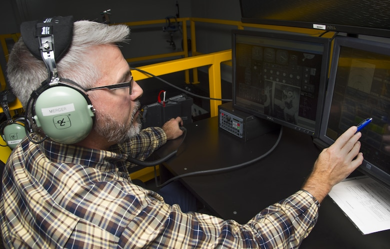 John Mercer, a Boom Operator Weapon System Trainer (BOWST) Instructor assigned to the 6th Operations Support Squadron, operates the instructor portion of the BOWST, Nov. 8, 2017, at MacDill Air Force Base, Fla. The BOWST trains Airmen on normal procedures and on possible malfunctions in a simulator.  (U.S. Air Force photo by Senior Airman Mariette Adams)