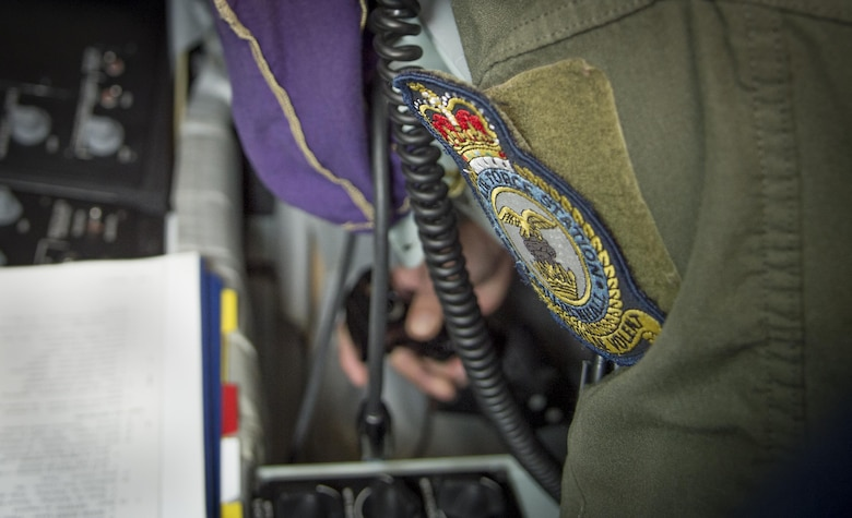 A Royal Air Force Mildenhall patch is attached to the flight suit of U.S. Air Force Tech. Sgt. Augie Marshall, wing scheduler assigned to the 100th Operations Support Squadron, as he operates the Boom Operator Weapons Systems Trainer (BOWST) Nov. 8, 2017, at MacDill Air Force Base, Fla. The BOWST creates a platform to instruct Airmen assigned to the MacDill BOWST to Airmen from around the world. (U.S. Air Force photo by Senior Airman Mariette Adams)