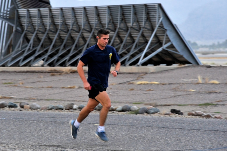 1st Lt. James Buckingham, 56th Civil Engineer Squadron engineer operations officer in charge, races towards the finish line of a 5K at Luke Air Force Base, Ariz., Nov. 17, 2017. Buckingham finished in first place with a time of 18:41. (U.S. Air Force photo/Airman 1st Class Pedro Mota)