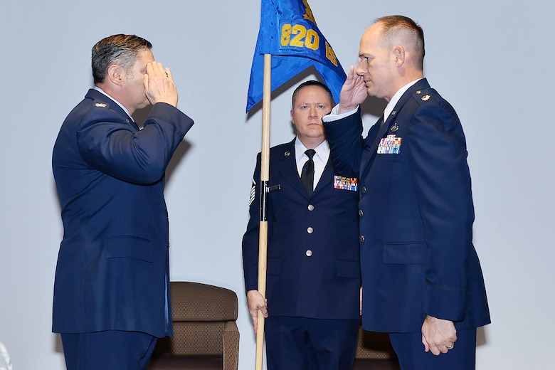 Lt. Col. Thomas P. Stauffer (right) assumes command of the 820th Intelligence Squadron during the unit's official activation and assumption of command ceremony officiated by Col. John McKaye, 655th Intelligence, Surveillance, and Reconnaissance Group commander, Nov. 4, 2017.