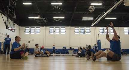Warrior play sitting volleyball