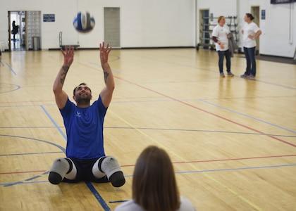Warrior plays sitting volleyball