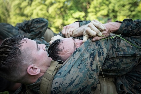U.S. Marines participate in ground free sparring during the culminating event of the Martial Arts Instructor Trainer course aboard Marine Corps Base Quantico, VA., June 21, 2017.