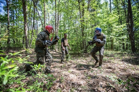 U.S. Marines participate in weapons free sparring during the culminating event of the Martial Arts Instructor Trainer course aboard Marine Corps Base Quantico, VA., June 21, 2017.