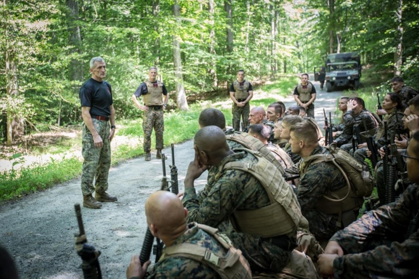 U.S. Marine Corps Lt. Col. (ret.) Joseph Shusko (left) speaks to the students of the Martial Arts Instructor Trainer Course aboard Marine Corps Base Quantico, VA., June 21, 2017.