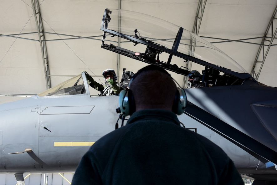 An F-15E Strike Eagle pilot and weapon systems operator with the 335th Fighter Squadron, prepare to taxi to participate in exercise Razor Talon, Nov. 17, 2017, at Seymour Johnson Air Force Base, North Carolina. The exercise provides service members a unique opportunity to participate in a monthly large-force training exercise for joint East Coast tactical and support aviation units. (U.S. Air Force photo by Airman 1st Class Kenneth Boyton)