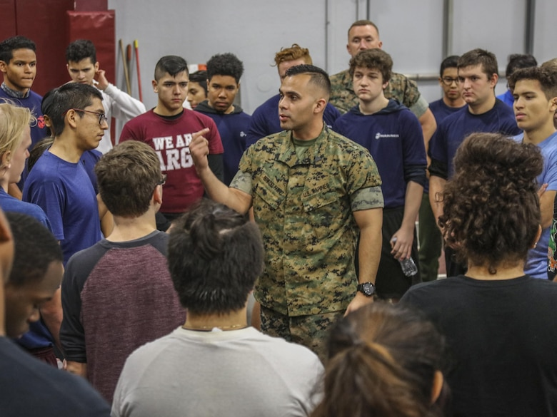 SUMMIT, Ill – Sergeant Mario Bermudez, a recruiter with Marine Corps Recruiting Sub Station Oak lawn, Recruiting Station Chicago, talks to students and poolees during the Semper Fi Saturday event in Summit, Illinois., Nov. 4. Semper Fi Saturday is an event that was created by the Marines of Recruiting Substation Oak Lawn in 2010,  to give high school students appreciation of the Marine Corps by giving them a first-hand experience into how Marines are made. (U.S. Marine Corps photo by Cpl. Quavaungh Pointer)
