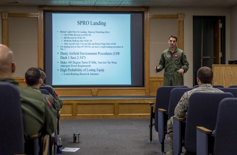 U.S. Air Force Capt. Jordan Novotny, an instructor pilot with the 58th Airlift Squadron briefs fellow aircrew members before the Altus Quarterly Exercise (ALTEX), Nov. 16, 2017 at Altus Air Force Base, Okla.