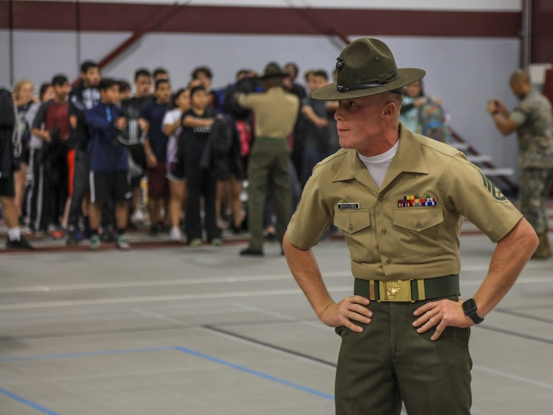 SUMMIT- U.S. Marine Corps SSgt. Edward Baracree, Drill Instructor with 3rd battalion, Kilo Company, Marine Corps Recruit Depot Parris Island, stares at a student during the Semper Fi Saturday event in Summit, Illinois., Nov. 4. Semper Fi Saturday is an event that was created by the Marines of Recruiting Substation Oak Lawn in 2010,  to give high school students appreciation of the Marine Corps by giving them a first-hand experience into how Marines are made. (U.S. Marine Corps photo by Cpl. Quavaungh Pointer)