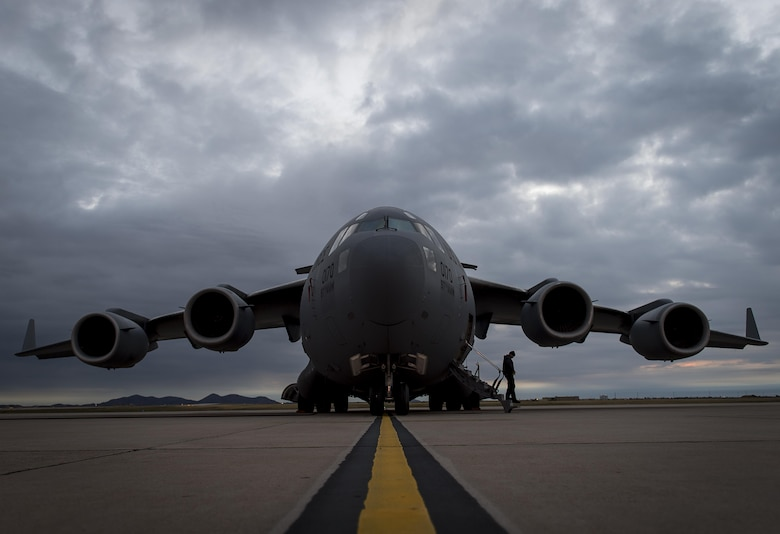 An A-Team member with the 97th Maintenance Group exits a C-17 Globemaster III during the Altus Quarterly Exercise (ALTEX), Nov. 16, 2017 at Altus Air Force Base, Okla.