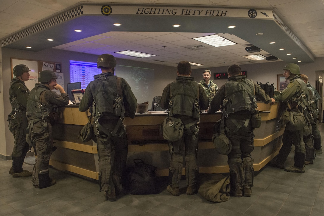 U.S. Air Force pilots assigned to the 55th Fighter Squadron meet for a pre-flight brief at the unit operations desk at Shaw Air Force Base, South Carolina, Nov. 16, 2017.