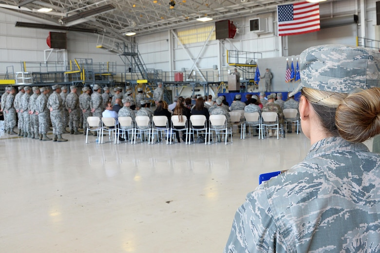 First Lt. Brianna Houston, 81st Training Wing Protocol Office chief of protocol, observes the 22nd Air Force change of command in the isochronal dock Nov. 14, 2017, on Keesler Air Force Base, Mississippi. The Protocol Office is in charge of ensuring every ceremony on Keesler goes to plan according to Air Force standards. (U.S. Air Force photo by Airman 1st Class Suzanna Plotnikov)