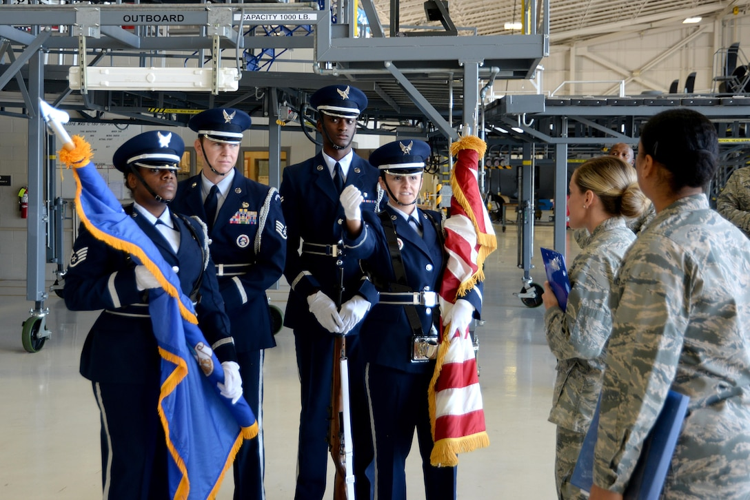 Keesler Air Force Base Honor Guardsmen clarify their marching route for the 22nd Air Force change of command ceremony with 81st Training Wing Protocol Office members in the isochronal dock Nov. 14, 2017, on Keesler Air Force Base, Mississippi. The Protocol Office is in charge of ensuring every ceremony on Keesler goes to plan according to Air Force standards. (U.S. Air Force photo by Airman 1st Class Suzanna Plotnikov)
