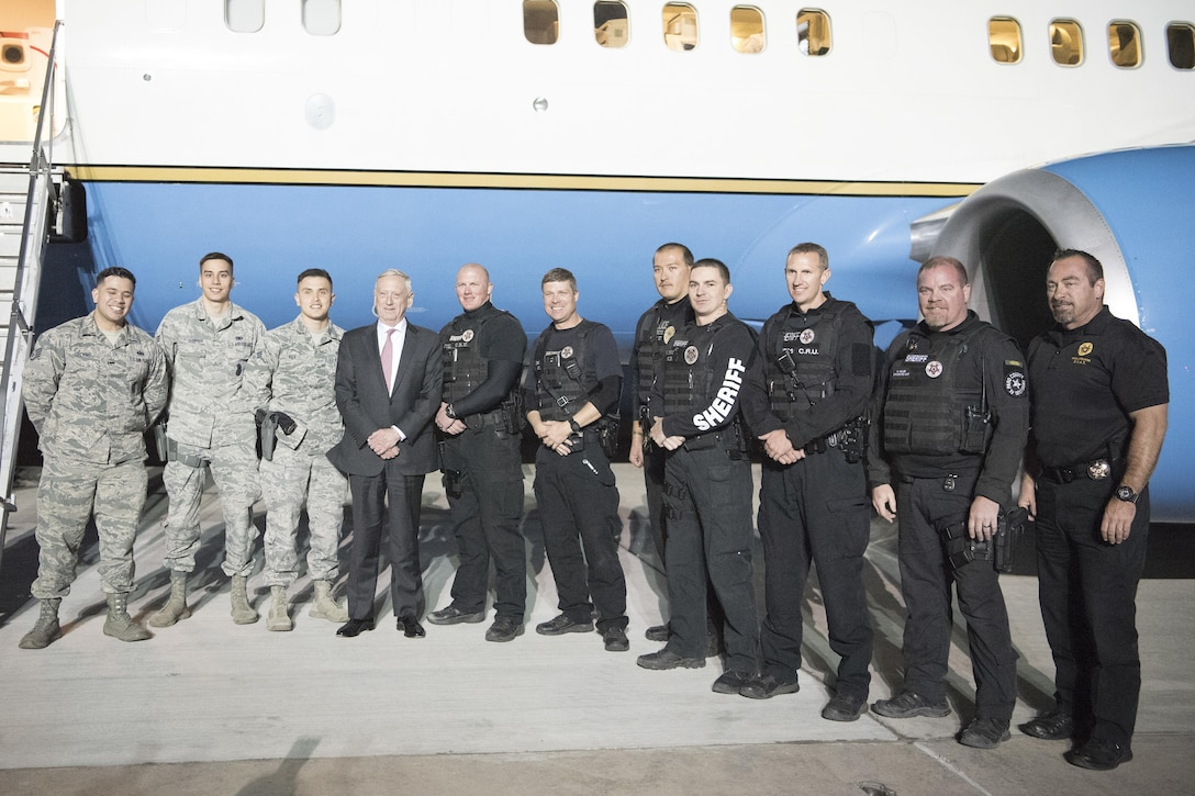 Secretary of Defense Jim Mattis poses for a photo with Airmen and members of the El Paso County Sheriff's Department at Peterson Air Force Base, Nov. 16. 2017.
