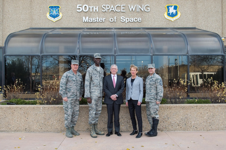SCHRIEVER AIR FORCE BASE, Colo.—Secretary of Defense Jim Mattis (center) stands with Gen. Jay Raymond, Air Force Space Command commander (far left), Col. Jacob Middleton, 50th Space Wing vice commander (second from left), Betty Sapp, National Reconnaissance Office director (second from right) and Chief Master Sgt. Jason Tiek, 50th SW Command Chief Master Sergeant (far right) in front of the 50th SW headquarters at Schriever Air Force Base, Colo., Nov. 16, 2017.  Mattis stopped by Schriever AFB after visiting Headquarters North American Aerospace Defense Command and U.S. Northern Command as part of his one-day trip to Colorado Springs. (U.S. Air Force photo by Dennis Rogers)
