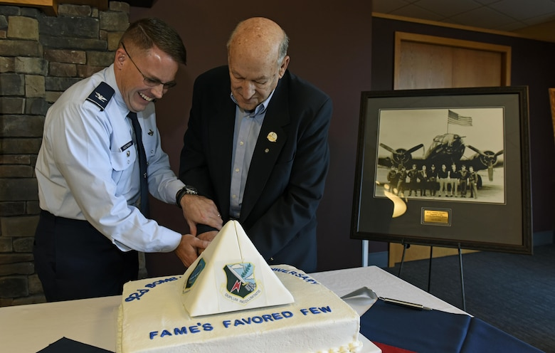 (left) Colonel J. Scot Heathman, 92nd Air Refueling Wing vice commander, and (right) Duane Wolfe, 92nd ARW Memorial Association president, cut a cake to commemorate the wing's 70th anniversary at Fairchild Air force Base, Wash., Nov. 17, 2017. The 92nd ARW has proven critical to fulfilling U.S. Strategic Command's vision of fighting and delivering integrated, multi-domain combat effects across the globe, wherever and whenever needed. (U.S. Air Force photo /Airman 1st Class Jesenia Landaverde)