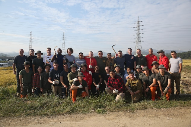 Republic of Korea Marines with ROK Marine Logistics Group and U.S. Marines with Combat Logistics Regiment 3, 3rd MLG, gather together before harvesting rice during a community service project, Oct. 27, 2017 in Pohang, South Korea. The ROK Marines and U.S. Marines helped local rice farmers harvest crops from fields damaged by Super Typhoon Lan during Exercise Winter Workhorse 17/ Korea Marine Exchange Program 18.1. The individual Marines and Sailors' relationships with their ROK counterparts and is the strength of III MEF in the Pacific. (U.S. Marine Corps photo by Sgt. Tiffany Edwards)