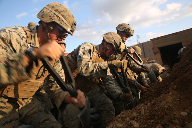 Combat engineers with Engineer Support Company, Combat Logistics Battalion 3, Combat Logistics Regiment 3, dig a trench while building an underground bunker, Oct. 28, 2017 at Rodriguez Live Fire Range, Paju, South Korea. The Marines with CLB-3 built an expeditionary base on the range to remain as a standing capability for future units that rotate through the training area. The base was built as a part of Exercise Winter Workhorse 17/ Korean Marine Exchange Program 18.1, which familiarizes the American armed forces with the Korean Peninsula and builds upon an enduring alliance between the two militaries. (U.S. Marine Corps photo by Sgt. Tiffany Edwards)