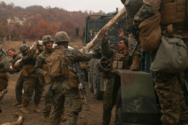 Combat engineers with Engineer Support Company, Combat Logistics Battalion 3, Combat Logistics Regiment 3, load an inert mine-clearing charge onto a trailer, Nov. 1, 2017 at Rodriguez Live Fire Range, Paju, South Korea. The Marines with CLB-3 practiced firing inert and live mine-clearing charges as a part of Exercise Winter Workhorse 17/ Korean Marine Exchange Program 18.1, which familiarizes the American armed forces with the Korean Peninsula and builds upon an enduring alliance between the two militaries. (U.S. Marine Corps photo by Sgt. Tiffany Edwards)