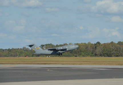 A C-17 Globemaster III aircraft takes off from Joint Base Charleston with equipment headed for Argentina, Nov. 18, 2017. Joint Base Charleston's efforts are helping aid the search and rescue of the A.R.A. San Juan, an Argentine navy submarine that went missing Nov. 15, 2017. As part of the support, two C-17 Globemaster IIIs and one C-5M Super Galaxy from Air Mobility Command are delivering needed equipment and expertise to assist a partner nation. The first flight from Joint Base Charleston is carrying a tow bar, a Tunner 60K Aircraft Cargo Loader and three members of the 437th Aerial Port Squadron. While on the ground, the team will be conducting runway assessments prior to other equipment arriving in country. Additional U.S. Air Force support will be provided to aid efforts.