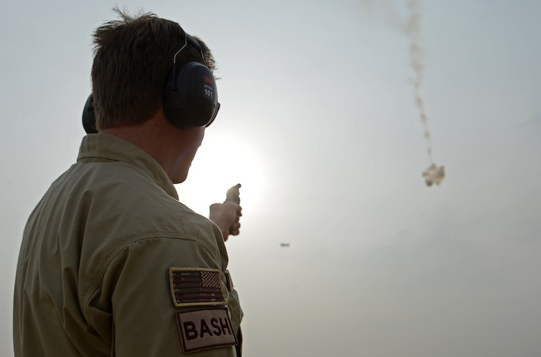 James Capps, 455th Air Expeditionary Wing U.S. Department of Agriculture (APHIS) and BASH forward operating base biologist, shoots off a pyrotechnic to harass a flock of Eurasian tree sparrows, Nov. 21, 2017 at Bagram Airfield, Afghanistan.