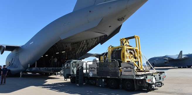 Cargo is loaded onto a military airplane.