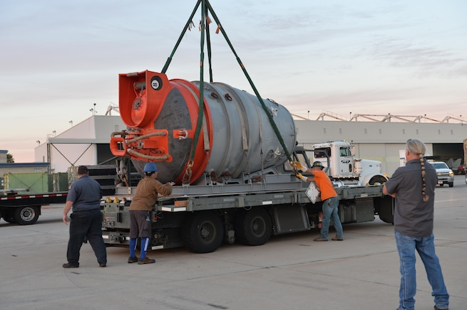 A Submarine Rescue Chamber is hoisted off a truck.