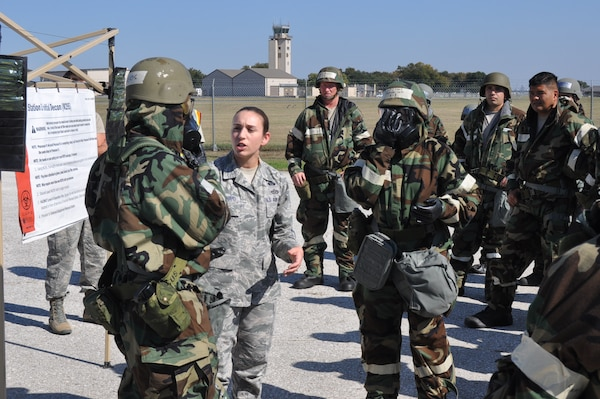 (Center) Senior Master Sgt. Leia Bernhard, 733rd Training Squadron first sergeant, provides guidance and training on how to properly go through the decontamination zone during an Ability to Survive and Operate training exercise on Joint Base San Antonio-Lackland, Texas on Nov. 18, 2017. Both ground Reserve Citizen Airmen and air crew members participated in the exercise and were required to go through a decontamination zone to prevent the spread of any potential chemicals spreading. (U.S. Air Force photo/Senior Airman Bryan Swink)
