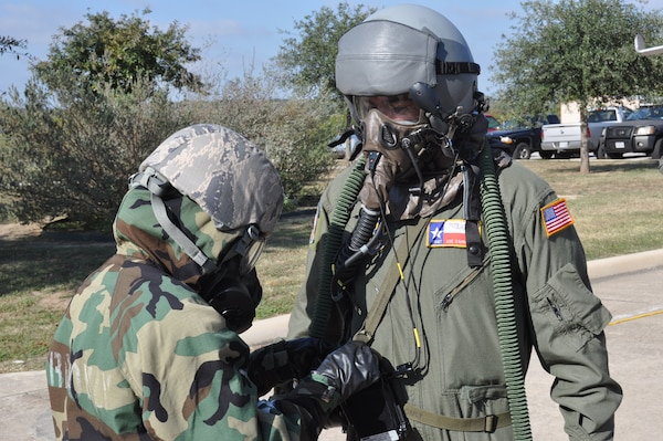 Tech. Sgt. Joseph Cannella, 68th Airlift Squadron loadmaster, goes through the decontamination process after a simulated chemical, biological, radiological and nuclear attack during an Ability to Survive and Operate training exercise on Joint Base San Antonio-Lackland, Texas on Nov. 18, 2017. ATSO training is designed to provide Airmen opportunities to respond and react to external threats in a simulated deployed environment. (U.S. Air Force photo/Senior Airman Bryan Swink)