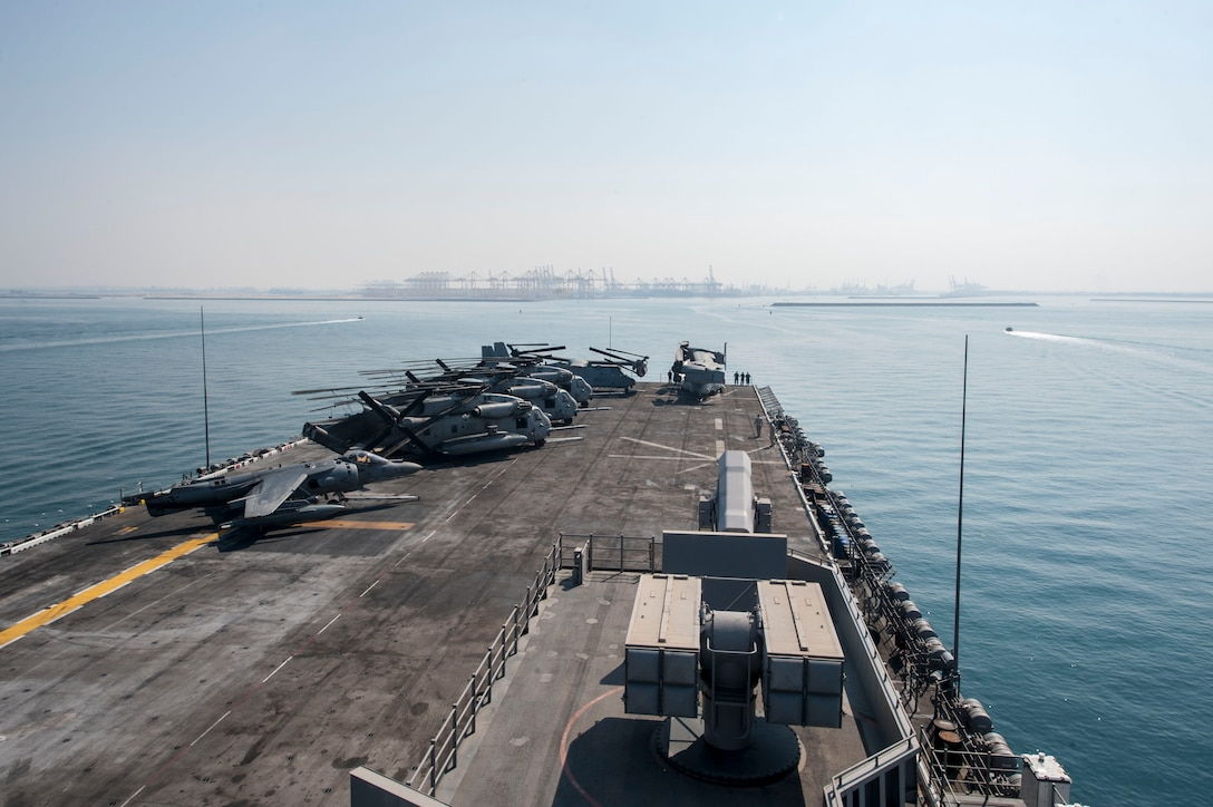 171110-N-ZS023-025 ARABIAN GULF (Nov. 10, 2017) The amphibious assault ship USS America (LHA 6) enters the port of Jebel Ali, United Arab Emirates for a port visit. America is deployed to the U.S. 5th Fleet area of operations in support of maritime security operations designed to reassure allies and partners, and preserve the freedom of navigation and the free flow of commerce in the region. (U.S. Navy photo by Mass Communication Specialist Seaman Vance Hand/Released)