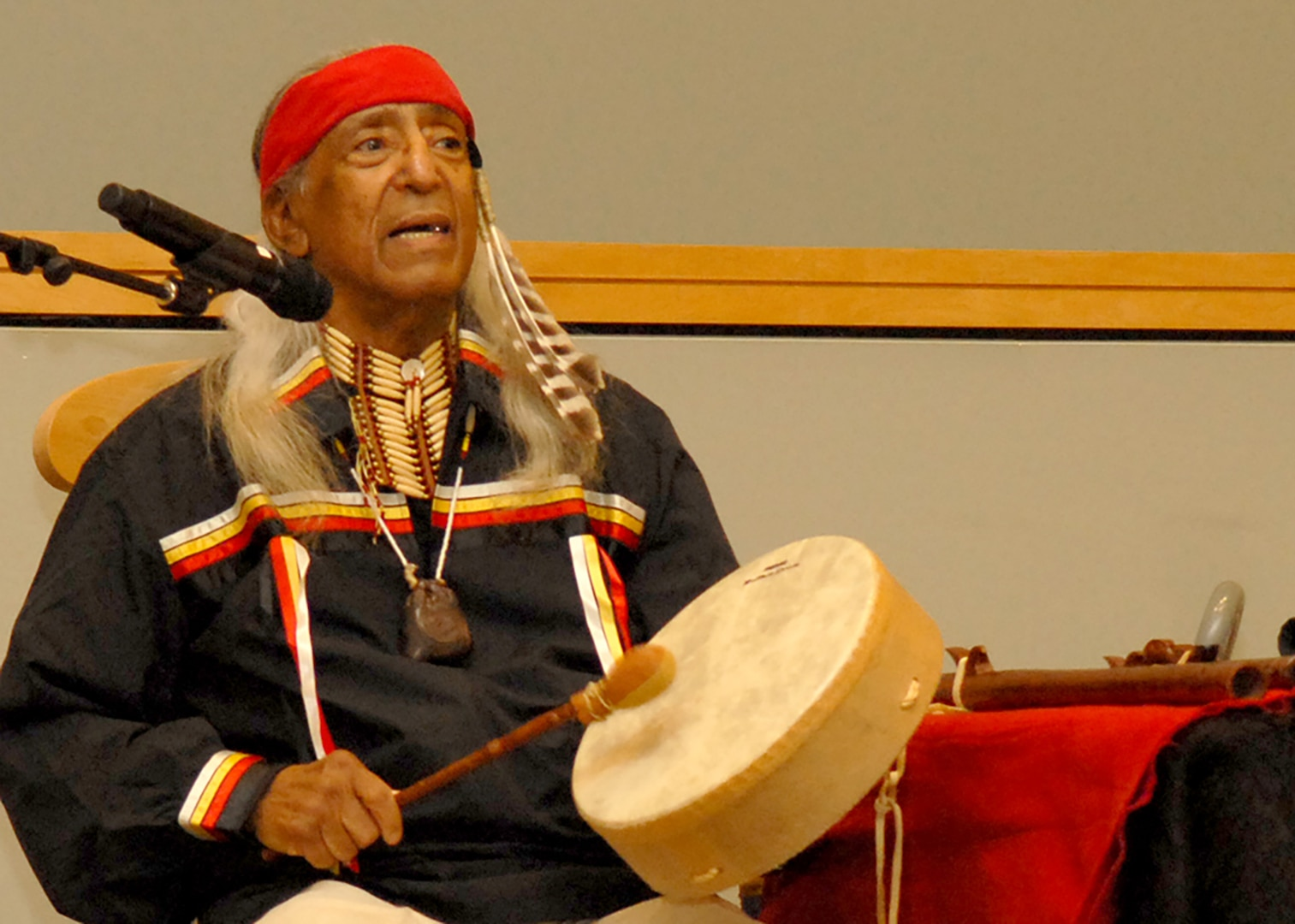 Kenneth Little Hawk, a descendent of the Micmac and Mohawk tribes, performs a song during the National American Indian Heritage Month program Nov. 14. Little Hawk encouraged the Naval Support Activity Philadelphia audience to accept people of all colors and creeds.