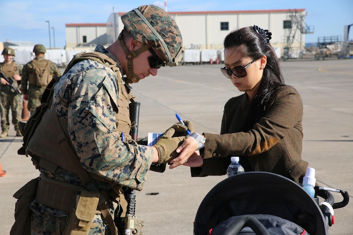A U.S. Marine assigned to Special Purpose Marine Air-Ground Task Force-Crisis Response-Africa processes a notional evacuee during non-combatant evacuation operation training aboard Naval Air Station Sigonella, Italy, on Nov. 17, 2017. SPMAGTF-CR-AF deployed to conduct limited crisis-response and theater-security operation in Europe and Africa.