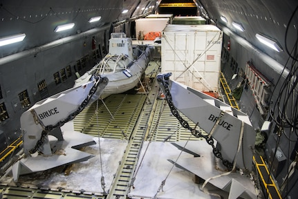 A U.S. Air Force C-5M Super Galaxy aircraft from the 22nd Airlift Squadron is loaded with U.S Navy rescue equipment at Marine Corps Air Station Miramar, Calif., Nov. 18, 2017. The equipment will be delivered to Argentina and used to aid in the search for the Argentina Navy submarine A.R.A San Juan. Air Mobility Command aircraft are delivering equipment and expertise to assist a partner nation. (U.S. Air Force photo by Staff Sgt. Nicole Leidholm)