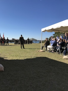 On Friday November 17th, 2017 at Courthouse Bay, Camp Lejeune, N. C., Lieutenant Colonel Mark George delivers remarks during Master Sergeant Shawn W. Fowler's retirement ceremony. LtCol George was the retiring officer and was MSgt Fowler's supervisor while he served as the Defeat the Device Branch head at Marine Corps Engineer School.