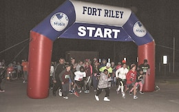 Runners and walkers alike take off from the start line for the GLO Run Oct. 27 that began at Sacco Softball Complex. Some donned costumes, while others were head to toe in glow sticks for the night time fun run.