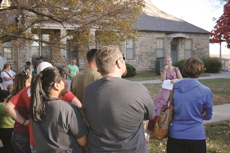 Maggy Gray, one of the pie queens of the Historical and Archeological Society of Fort Riley, acts as tour guide for the 21st annual HASFR Ghost Tour Oct. 29 where attendees heard about Fort Riley's haunting past.
