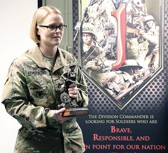 Staff Sgt. Brittany Armstrong gives a speech after winning the 1st Infantry Division Career Counselor of the Year award Oct. 4 at Fort Riley. The speech was a reflection of all the hard work and dedication she put into not only winning but developing further as a career counselor.