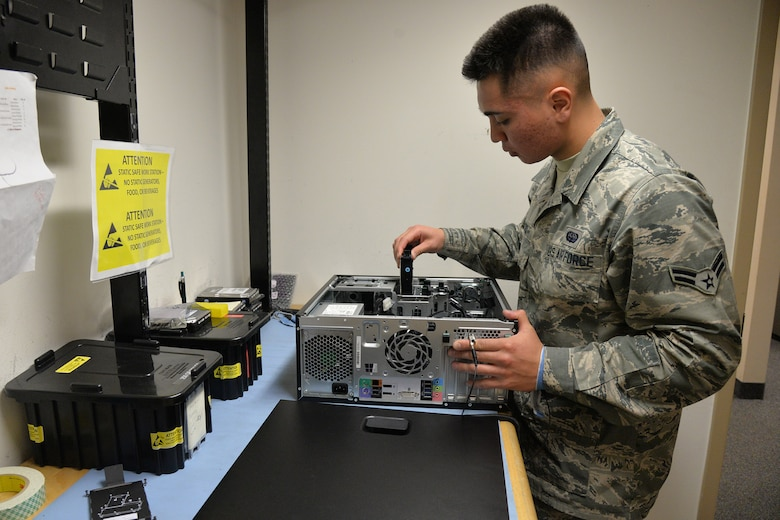 Airman 1st Class Haden-Paul Cruz, 341st Communications Squadron client support technician, replaces a hard drive Nov. 15, 2017, at Malmstrom Air Force Base, Mont.