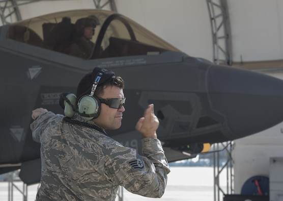 U.S. Air Force Staff Sgt. Jon Peek, 58th Aircraft Maintenance Unit crew chief, marshals an F-35A Lightning II from the 33rd Fighter Wing Nov. 14, 2017, at Eglin Air Force Base, Fla. The 33 FW supported Checkered Flag 18-1, a large scale air-to-air only exercise that emphasizes the execution and production of tactics between fourth and fifth generation aircraft. Checkered Flag is one of the few exercises where fifth generation aircraft participate as aggressors, allowing for realistic training against peer-like adversaries. (U.S. Air Force photo by Staff Sgt. Peter Thompson/Released)