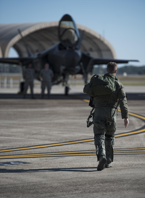 U.S. Air Force Lt. Col. Jared Santos, 513th Electronic Warfare Squadron commander, walks to an F-35A Lightning II Nov. 14, 2017, at Eglin Air Force Base, Fla. The 33rd Fighter Wing supported Checkered Flag 18-1 from home station. The wing launched 44 sorties in conjunction with the on-going F-35 pilot training here. (U.S. Air Force photo by Staff Sgt. Peter Thompson/Released)