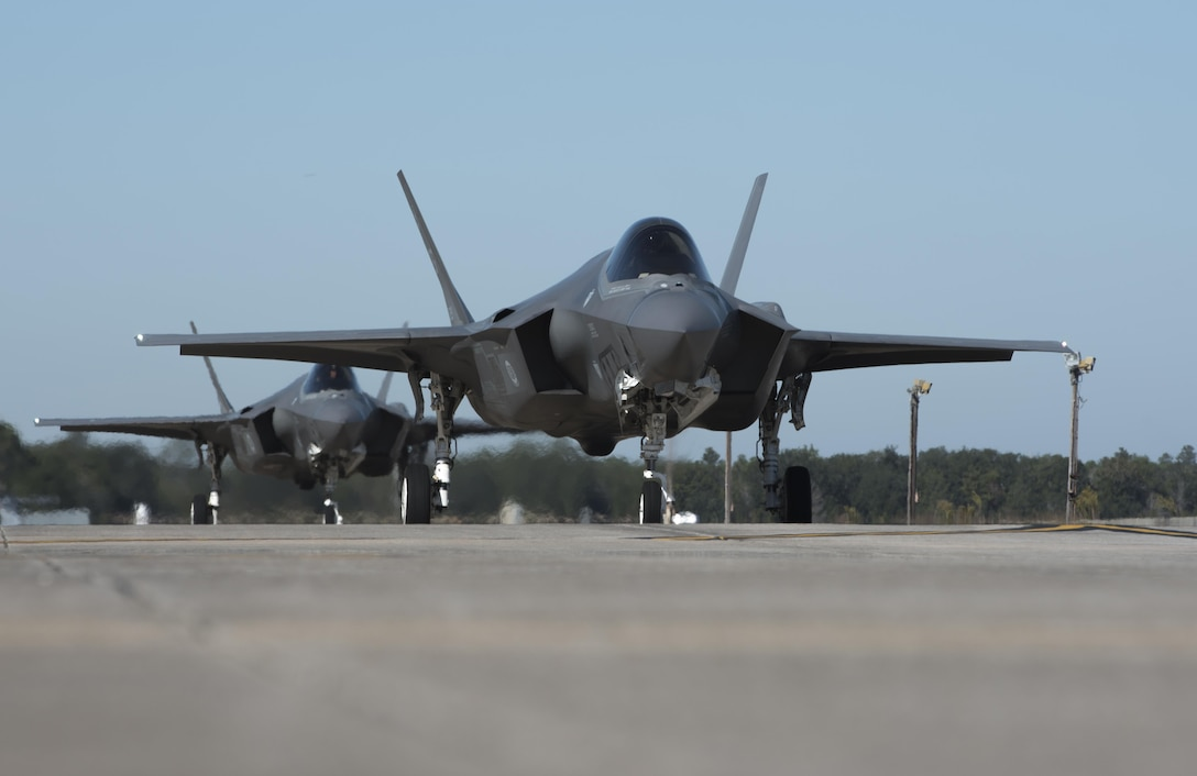 Two F-35A Lightnings II from the 33rd Fighter Wing taxi towards the runway Nov. 14, 2017, at Eglin Air Force Base, Fla. The 33 FW supported Checkered Flag 18-1 from home station. Checkered Flag is a large scale air-to-air only exercise that emphasizes the execution and production of tactics between fourth and fifth generation aircraft. (U.S. Air Force photo by Staff Sgt. Peter Thompson/Released)