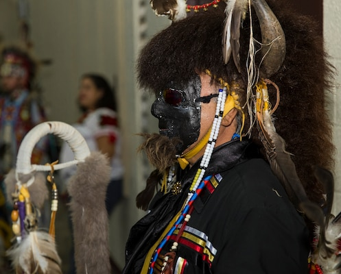 Isaac Cardenas, a member of the American Indians in Texas Dance Theater group, awaits to perform a dance at the National American Indian Heritage Month Observance Nov. 16 at the U.S. Army Medical Department Center and School, located at Joint Base San Antonio-Fort Sam Houston.