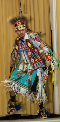Jose Garcia II, a member of the American Indians in Texas Dance Theater group, performs a traditional Native American dance at the National American Indian Heritage Month Observance Nov. 16 at the U.S. Army Medical Department Center and School, located at Joint Base San Antonio-Fort Sam Houston.