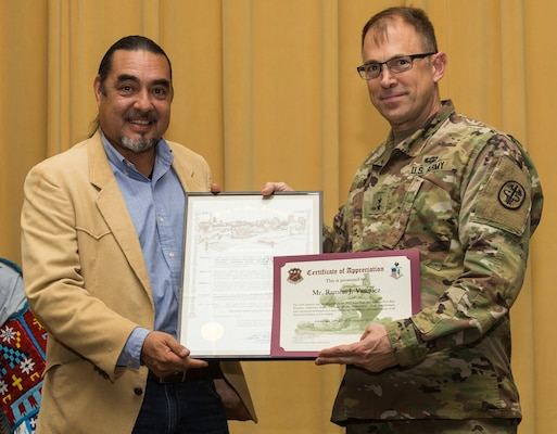 Ramon Vasquez, executive director and tribal historian for American Indians in Texas at the Spanish Colonial Missions, receives a copy of a proclamation from the city of San Antonio recognizing National American Indian Heritage Month and a certificate of appreciation from Maj. Gen. Brian Lein, U.S. Army Medical Department Center and School commanding general, during the National American Indian Heritage Month Observance Nov. 16 at AMEDDC&S, located at Joint Base San Antonio-Fort Sam Houston.