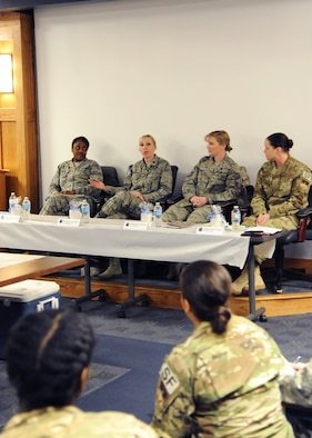 """From left to right, Lt. Col. LaShauna Lindsey, 341st Communications Squadron commander; Maj. Naomi Franchetti, 341st Missile Maintenance Squadron commander; Chief Master Sgt. Minnette Bohlander, 341st Maintenance Group superintendent; and Senior Master Sgt. Tessa Fontaine, 341st Security Support Squadron security forces manager, discuss a topic during the first """"Let's Connect"""" event Nov. 16, 2017, at Malmstrom Air Force Base, Mont. """"Let's Connect"""" is a professional development directed primarily toward females but is open to anyone to help individuals understand their peers, leaders and subordinates better. (U.S. Air Force photo by Christy Mason)"""