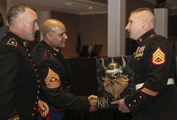 Maj. Andrew Nicholson, the Recruiting Station Twin Cities commanding officer, awards Staff Sgt. John Bateman the RS Twin Cities recruiter of the year award. Bateman, who is in his second year of recruiting, says he owes his success to hard work and dedication to the Marine Corps. (Official U.S. Marine Corps photo by Sgt. Michelle Reif)